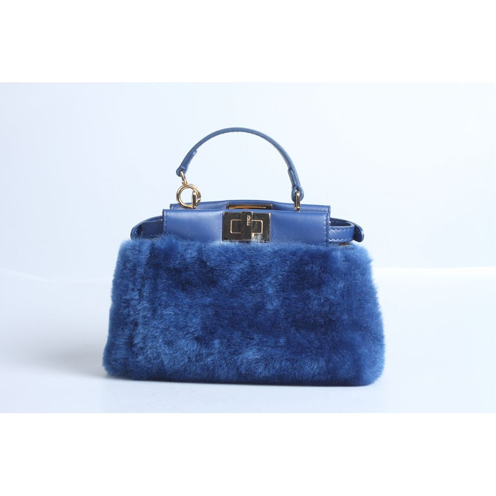 06dd685f FENDI Blue shearling and leather micro 'Peekaboo'